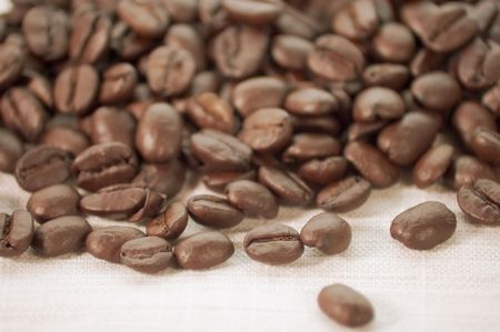pile of coffee beans on burlap cloth