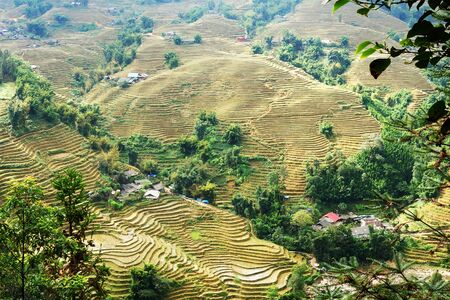 Distant view over mountain landscape with rice fields at Yen Minh near Ha Giang in Northern Vietnam Stockfoto