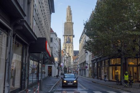 Street scene in Antwerp, Belgium with view on cathedral in scaffoldings Archivio Fotografico