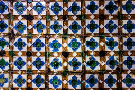 Traditional tiled wall decoration in a palace in Seville, Spain