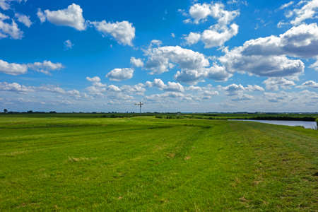 Panoramic view of a meadow with old fashioned windmill near Eemnes, Netherlands