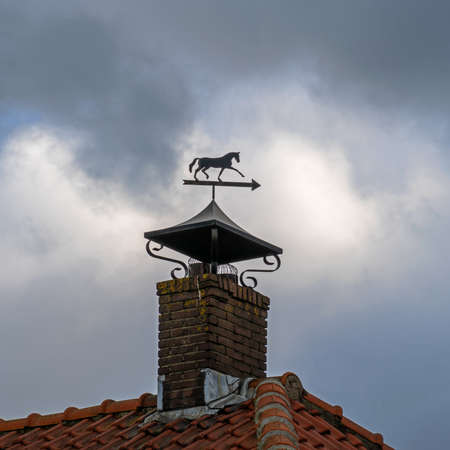 Chimney with weathervane in the shape of a horse