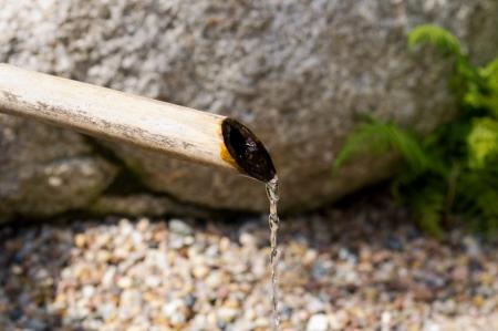 Bamboo fountain in Japanese garden Stock Photo