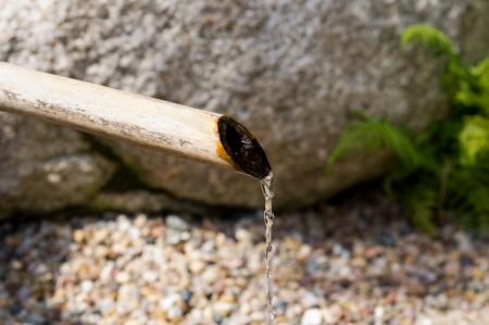 bamboo fountain: Bamboo fountain in Japanese garden Stock Photo