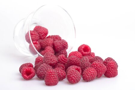 raspberries spilled out of the cup