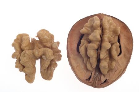 Walnuts, one broken walnut on a white background