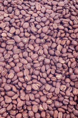 spilled coffee beans as background