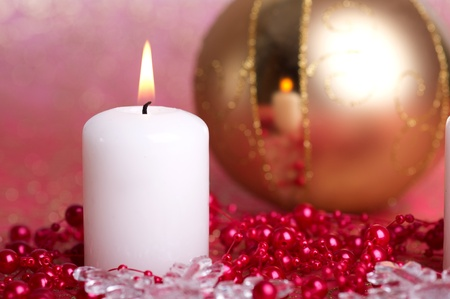 Christmas decoration, gold bauble and white candle