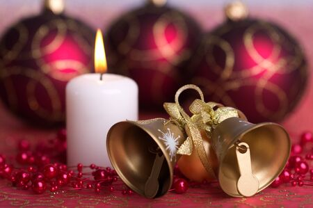 golden bells, in the background candle and red balls
