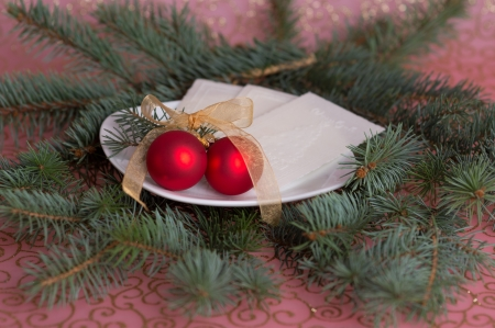 red baubles on a plate with wafers Stock Photo