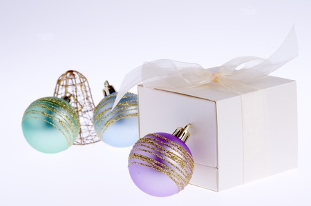 gift box and colorful baubles and bell photo