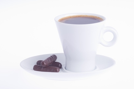 coffee with three chocolates on a saucer on a white background