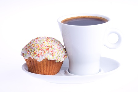 coffee with a cupcake with sprinkles on a saucer on a white background photo