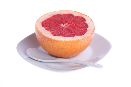 red grapefruit on a plate on a white background photo