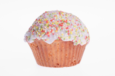 muffin glazed with colored sprinkles on a white background photo