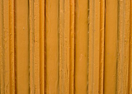 wooden wall covered with peeling paint