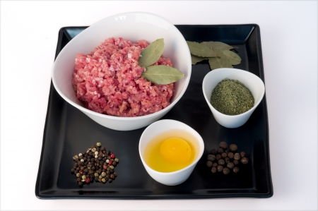 minced meat, egg, colored pepper, bay leaves and allspice photo