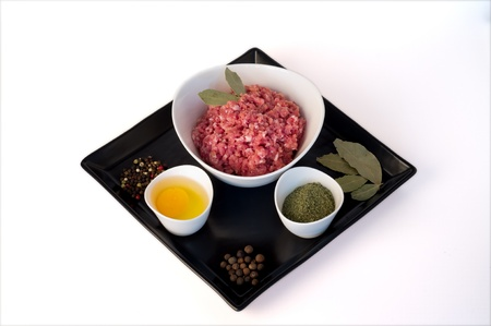 minced meat, egg, colored pepper, bay leaves and allspice Stock Photo - 17446029