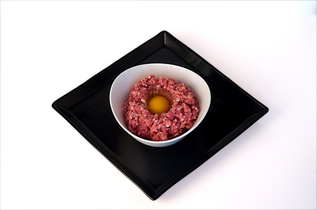 minced meat with egg stuck in a white bowl on a stone tray Stock Photo - 17446053