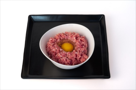 minced meat with egg stuck in a white bowl on a stone tray Stock Photo - 17446030