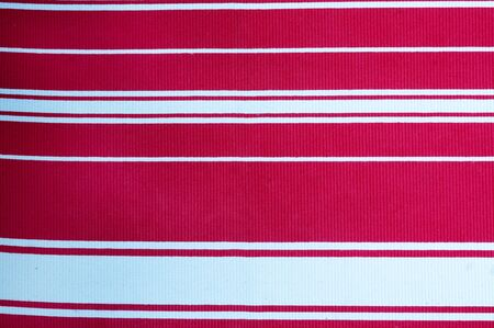 old textile in red and white stripes