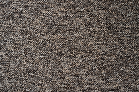 Low close up view of furry carpet texture background