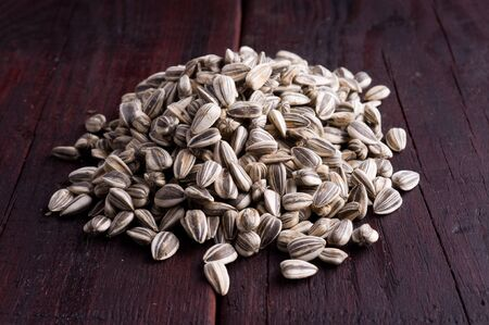 sunflower seeds scattered on the old planks Stock Photo
