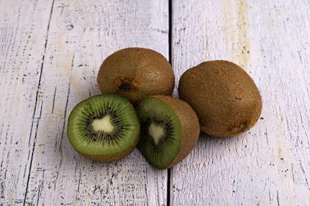 kiwi fruit on the old wooden planks Stock Photo