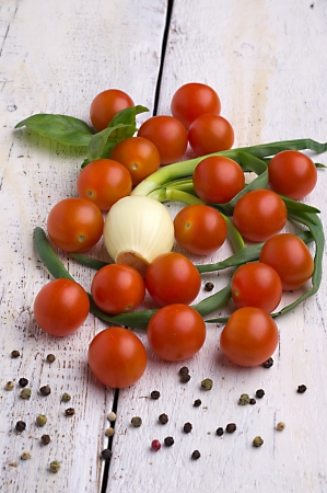Fresh sweet tomato on the wooden table photo