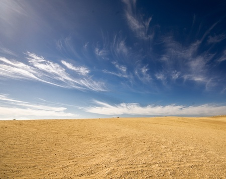 desert landscape, dunes, sky in the background photo