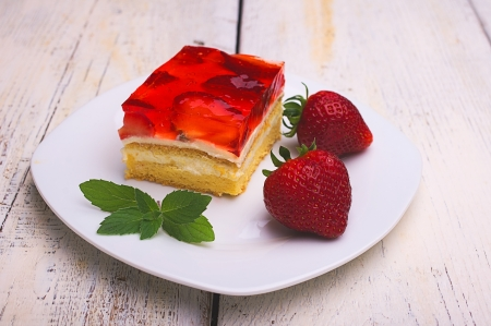 cake with strawberries and strawberry jelly with cream pudding