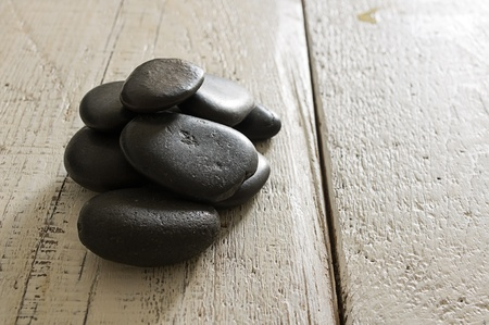massage stones on the old wooden boards Stock Photo