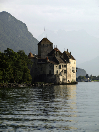 chillon: Switzerland, Montreux. Chillon Castle located on the shores of Lake Geneva Editorial