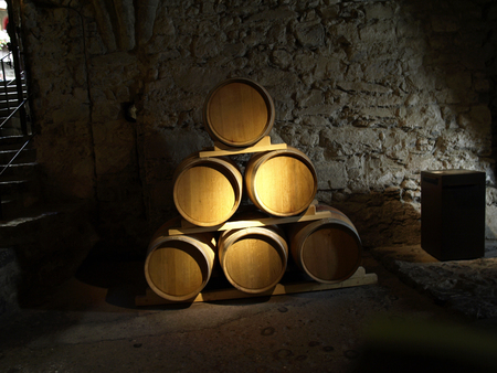 Old wine barrels in the dungeon of the castle, switzerland