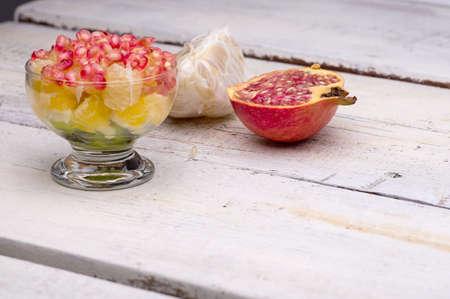fruit salad, pomegranate, kiwi, orange, pomelo