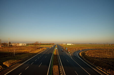 separating: highway, with a belt separating, view from the viaduct, at sunrise