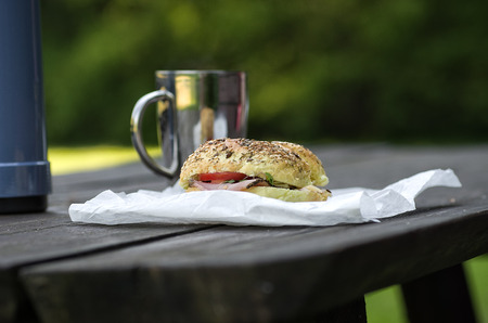 Breakfast in the park, thermos, sandwich and cup Stock Photo