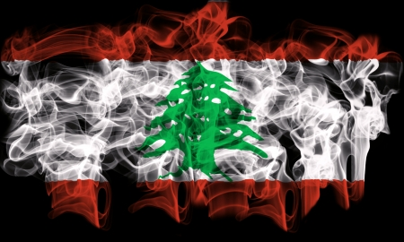 smoking flag of lebanon Stock Photo