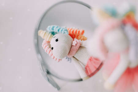Funny toy unicorn. Knitted handmade toy. Children toys