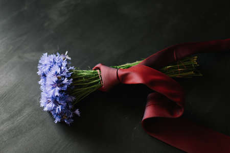 bouquet of cornflowers on a dark background. wedding details, bridal bouquet. wild flowers