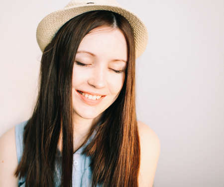 portait of a beautiful young smiling woman wearing summer hat Stock fotó