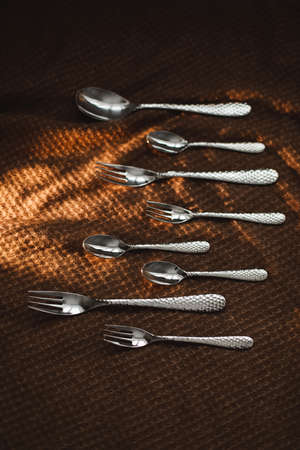 silver stainless cutlery on a dark fabric background Stock fotó