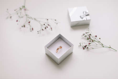 Golden ring and jewelry box and flowers. Wedding, Love, Valentines day, Happy Birthday, Proposal of marriage concept Stock fotó