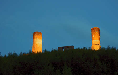 Ruined medieval castle with tower in Checiny by night, Poland photo