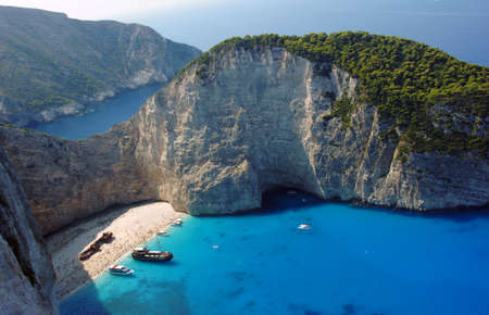 boats and shipwreck beach at Zakynthos island, Greece photo