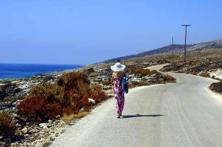 seaboard: girl walking on seaboard, Zakynthos island, Greece Stock Photo