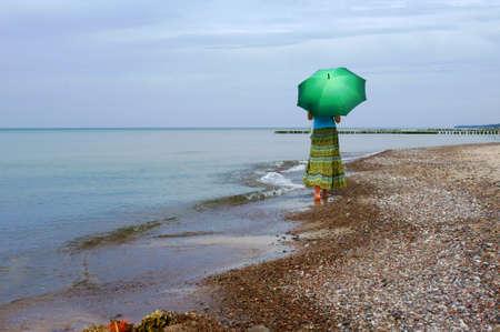 bulwark: Girl with umbrella on beach, Baltic, Poland