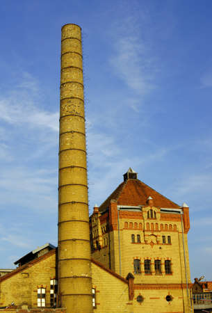 smokestack and townhouses in old factory, Poland Stock Photo - 16704981
