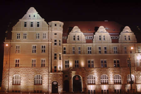 poznan: buildings university in Poznan by night