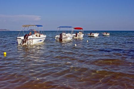 motorboats: bay with motorboats on Zakynthos island, Greece Editorial